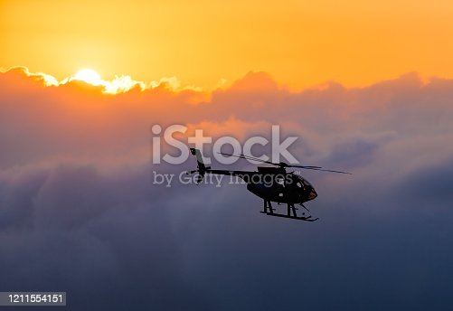 Hawaiian helicopter flying toward Killauea crater