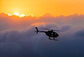 Hawaiian helicopter flying toward Killauea crater