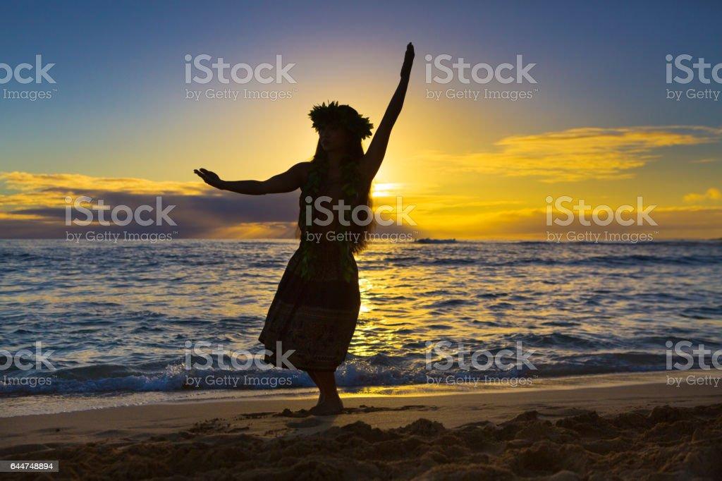 Hawaiian Hula Dancer Dancing on Beach at Sunset stock photo