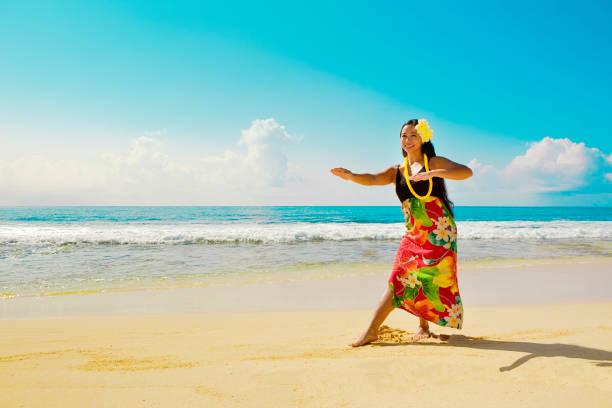 hawaiian hula dancer dancing on the beach - hawaiian ethnicity stock photos and pictures