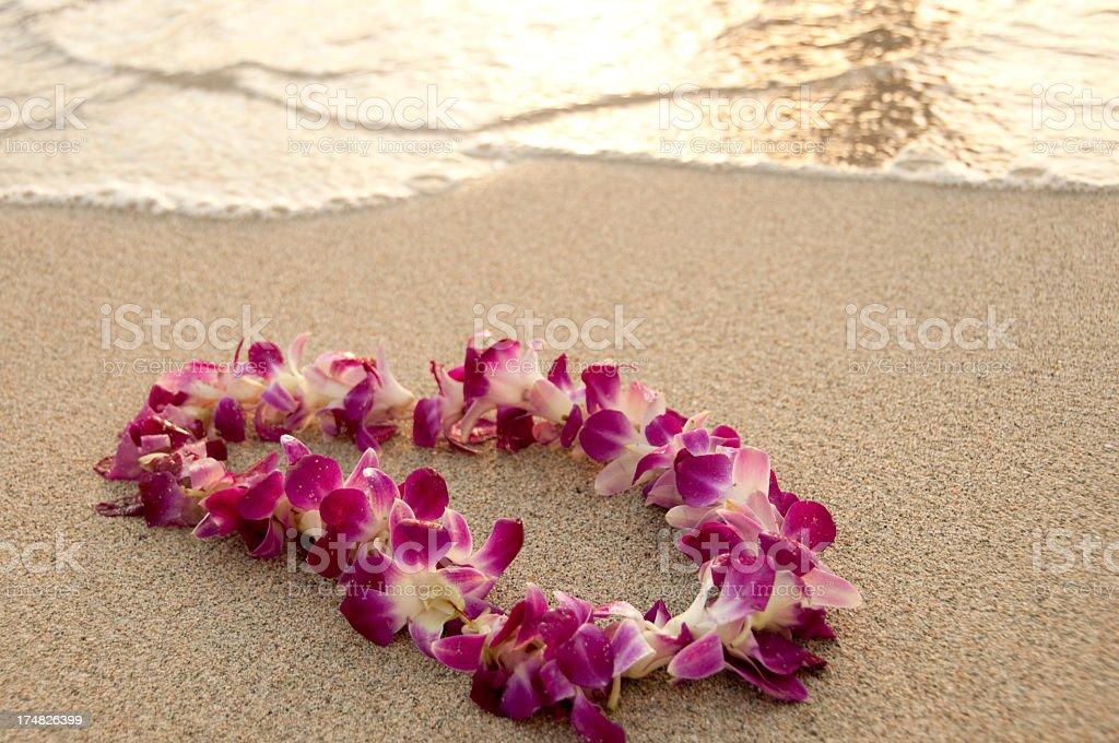 Hawaiian Lei on a Sandy Beach stock photo