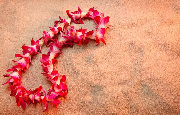 hawaiian lei on the beach stock photo