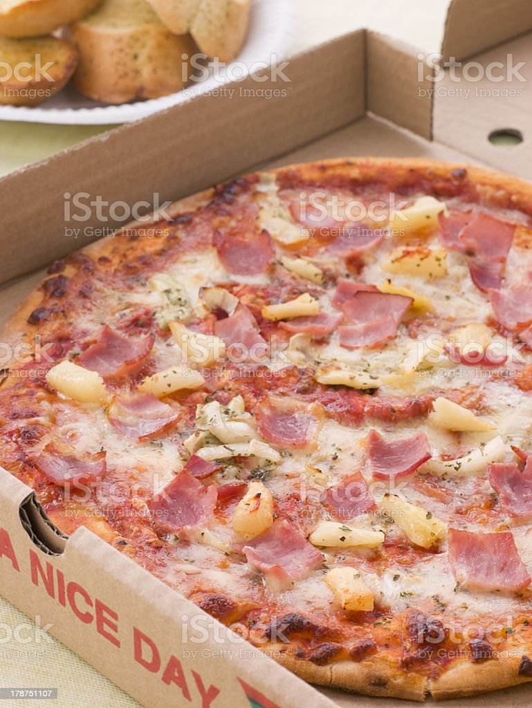 Hawaiian Pizza In A Take Away Box With Garlic Bread royalty-free stock photo