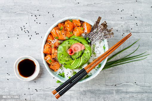 istock Hawaiian salmon poke bowl with seaweed, avocado rose, sesame seeds and scallions. Top view, overhead, flat lay, copy space 862671460