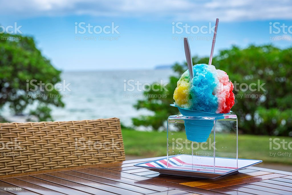 Hawaiian Shaved Ice Treat on Table at Tropical Beach stock photo