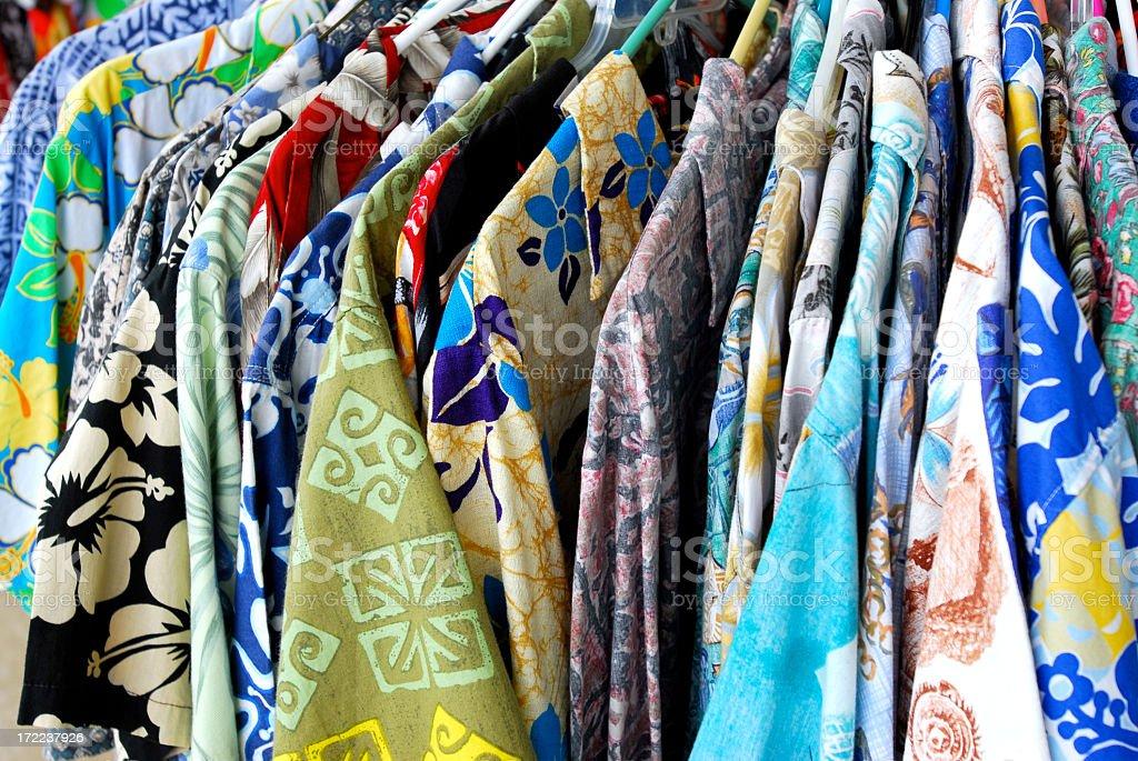 Hawaiian shirts hanging up on clothes hangers royalty-free stock photo
