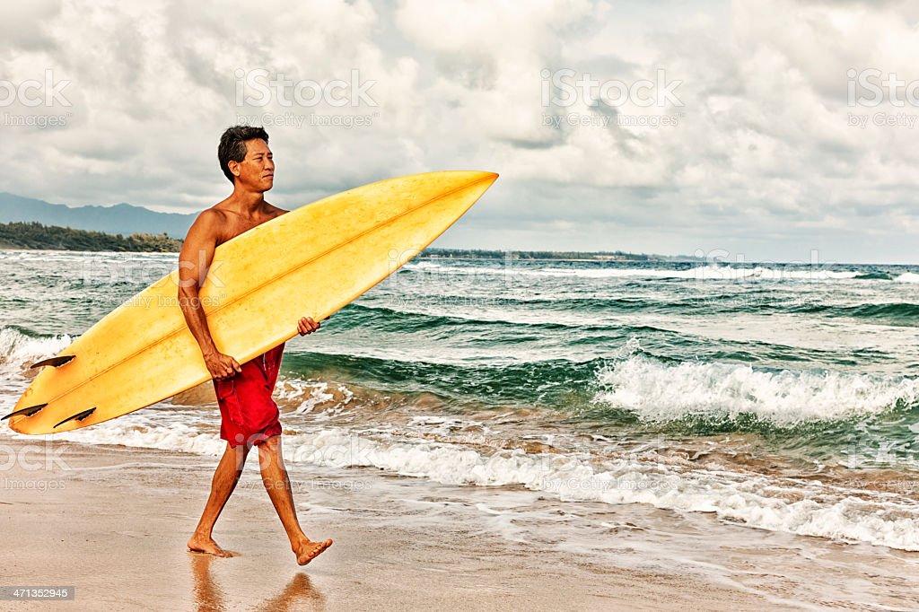 Hawaiian Surfer Walking with Surfboard royalty-free stock photo