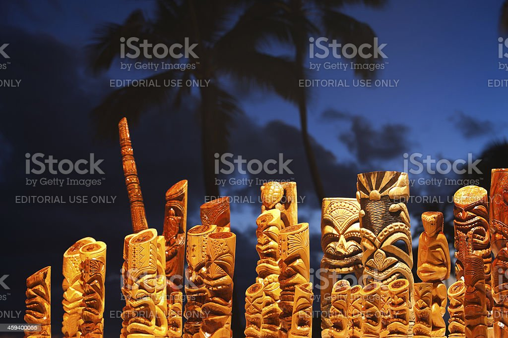 Hawaiian tiki mask art and blue palm tree sky. royalty-free stock photo