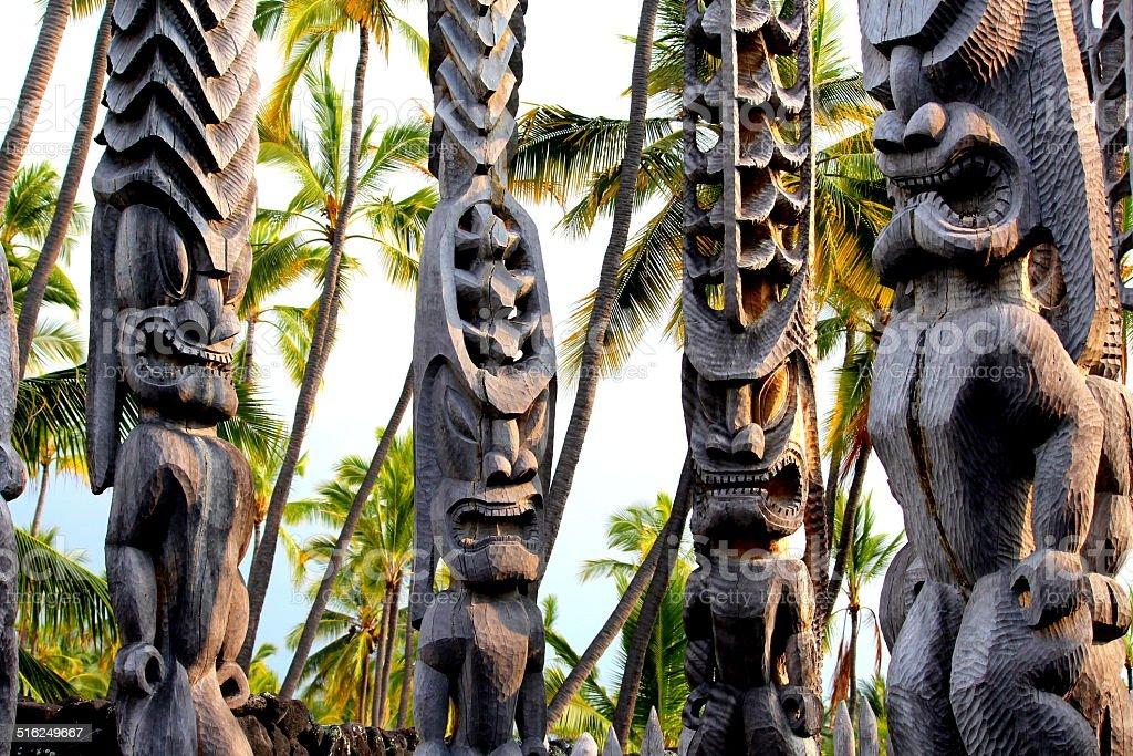 Hawaiian Tikis Standing at the Place of Refuge, Kona, Hawaii stock photo