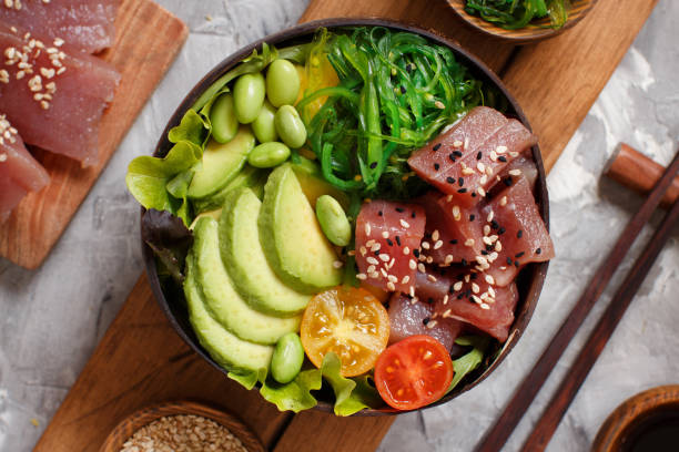 Hawaiian tuna poke bowl Hawaiian tuna poke salad in the bowl top view tuna seafood stock pictures, royalty-free photos & images