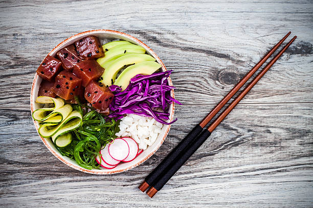 hawaiian tuna poke bowl with seaweed, avocado, red cabbage, radishes - ポキ ストックフォトと画像