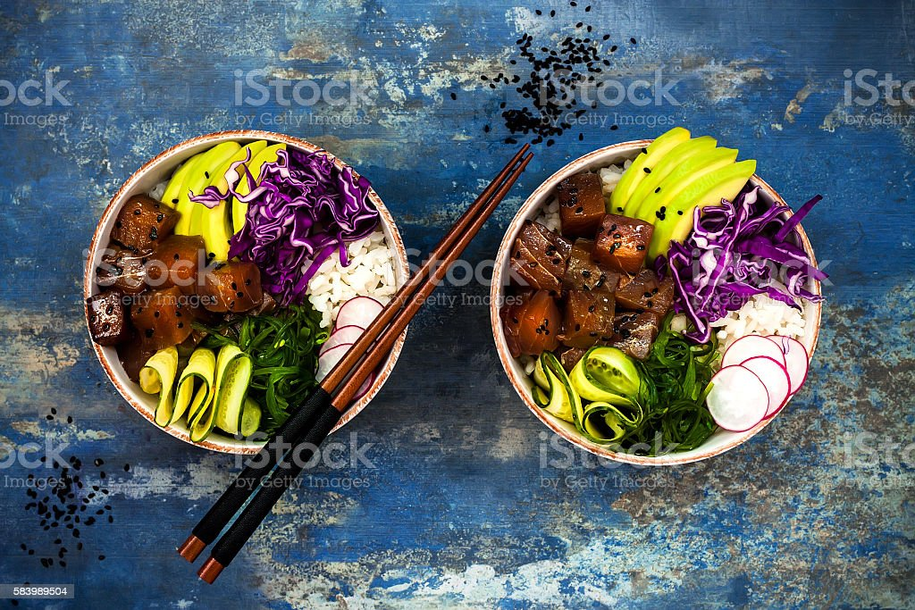 Hawaiian tuna poke bowl with seaweed, avocado, red cabbage, radishes stock photo