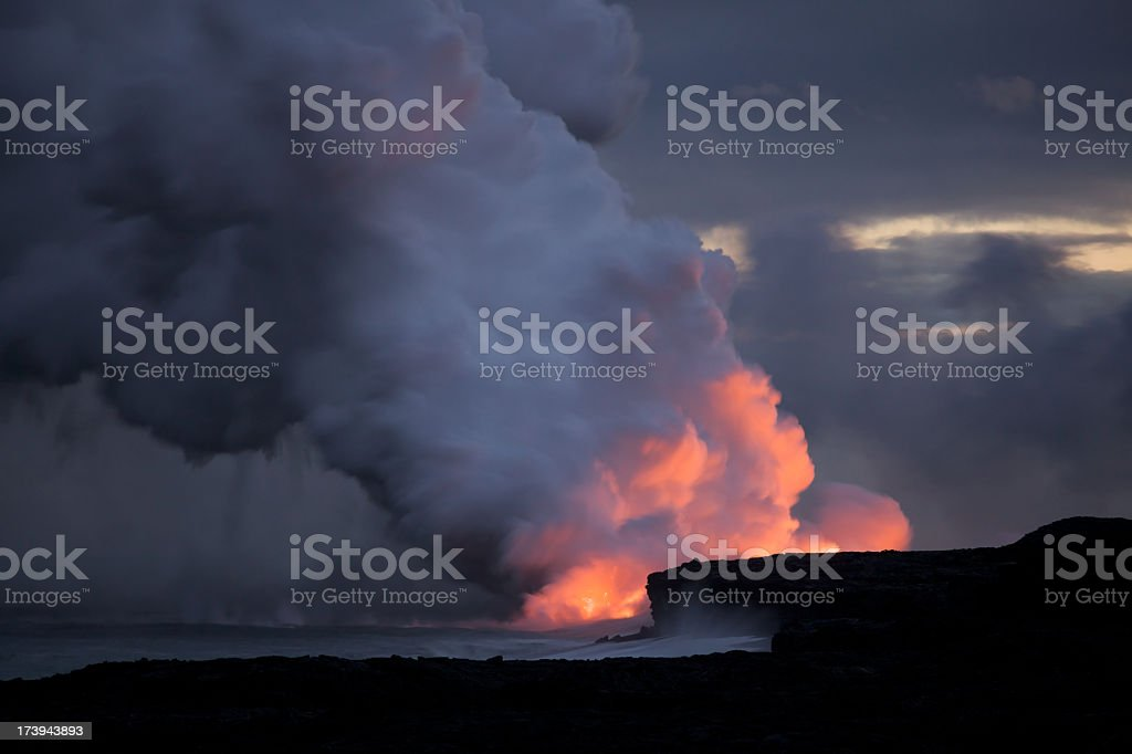 Hawaiian Volcano Kilauea Erupts Lava into The Pacific Ocean royalty-free stock photo