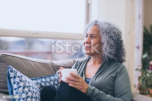 istock Hawaiian woman doing yoga pose inside in morning. 804802532