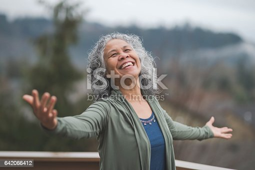 istock Hawaiian woman doing yoga pose outside 642066412