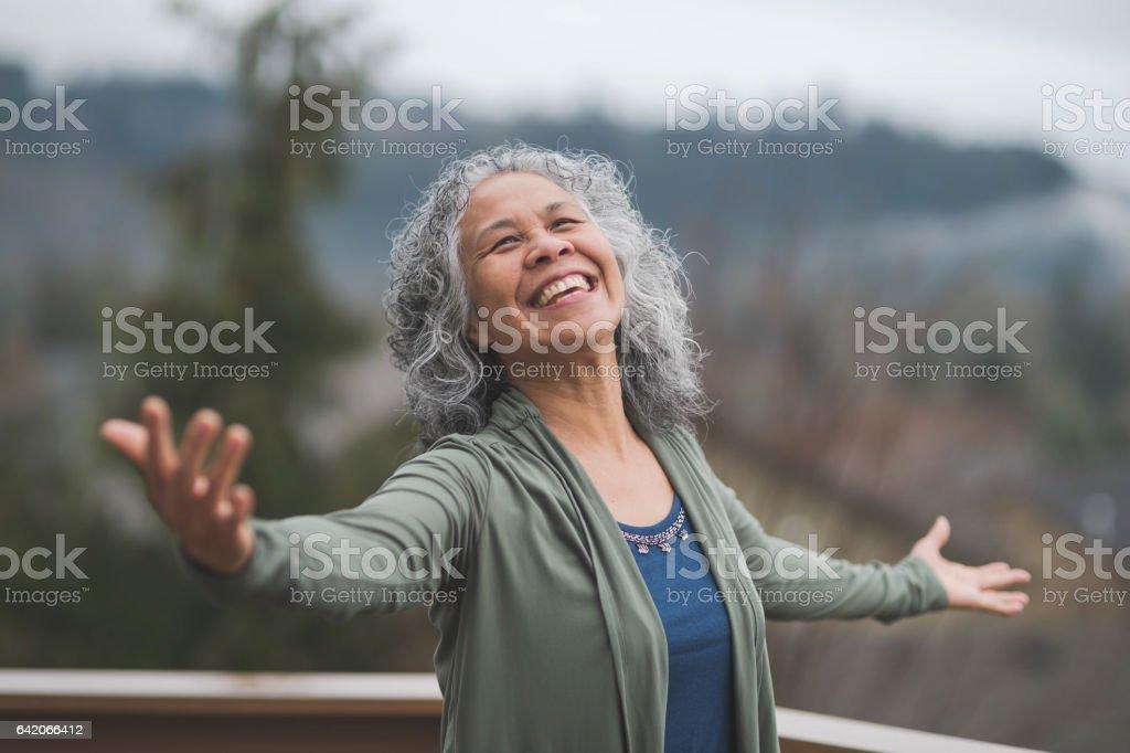 Hawaiian woman doing yoga pose outside stock photo