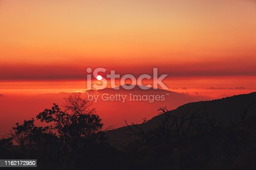 hawaiin sunset over mauna kea and haleakala volcano, seen from mauna kea volcano on big island, hawaii islands, usa.