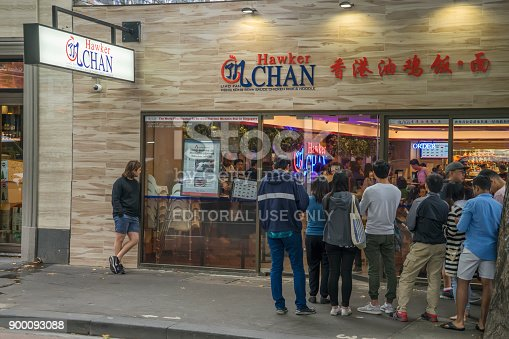Melbourne, Australia - December 30, 2017: Customers wait in line outside Hawker Chan, a new eatery on Lonsdale Street. Hawker Chan is an offshoot of founder/chef Chan Hon Meng's hawker stall in Singapore, which has the distinction of being awarded a Michelin star.