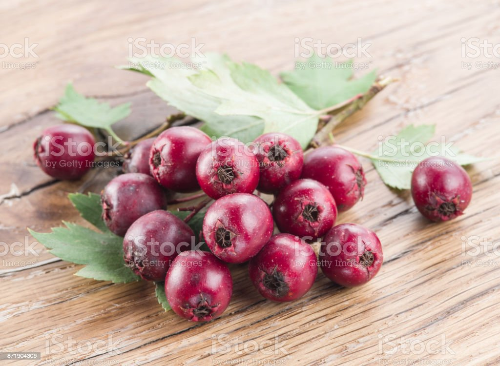 Hawthorn berries on the wooden table. stock photo
