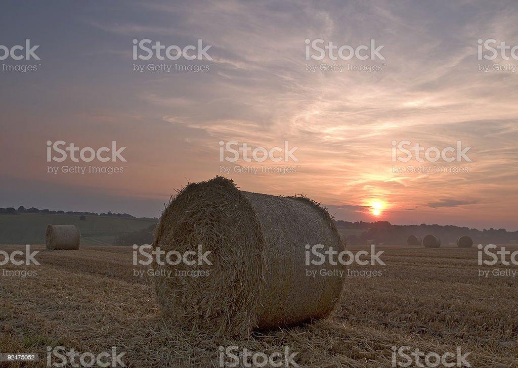 Hay bail sunset royalty-free stock photo
