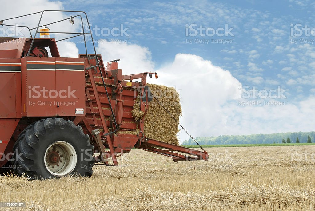 hay baler in the field royalty-free stock photo