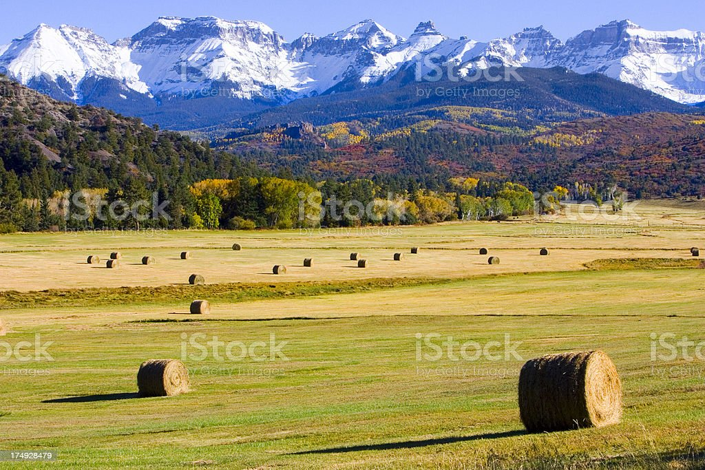 Hay bales below mountains royalty-free stock photo