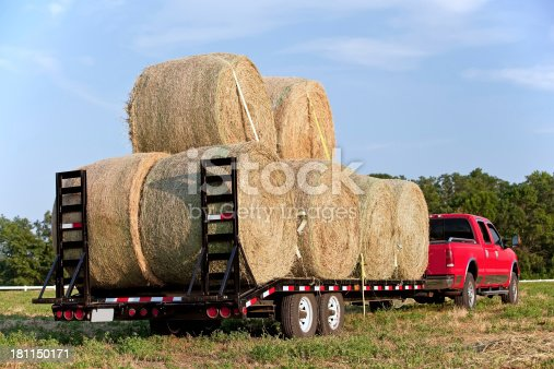 Load of hay bales strapped down and ready to be hauled.