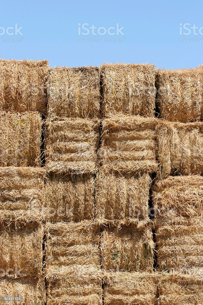 hay bales wall against blue sky royalty-free stock photo