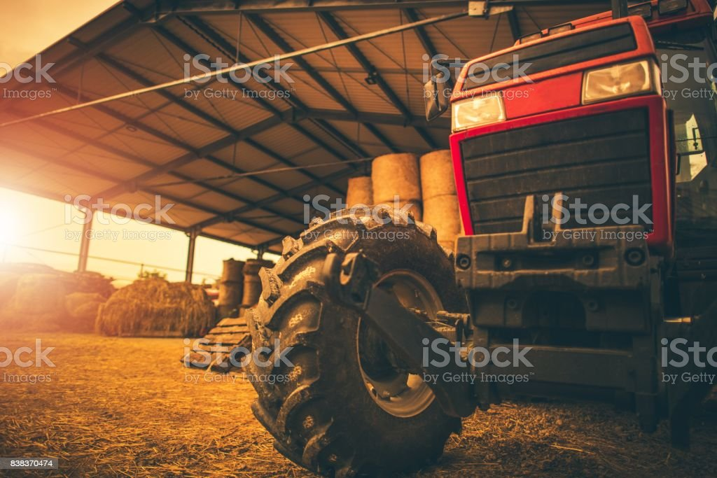 Hay Storage and the Tractor stock photo