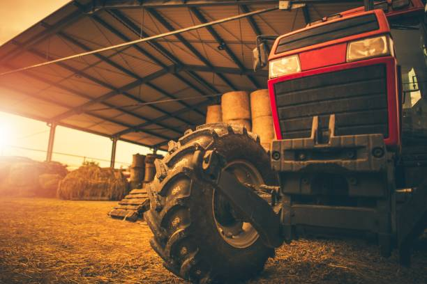 Hay Storage and the Tractor Hay Storage and the Tractor. Farming and Agriculture Theme. Heavy Duty Tractor. agricultural equipment stock pictures, royalty-free photos & images