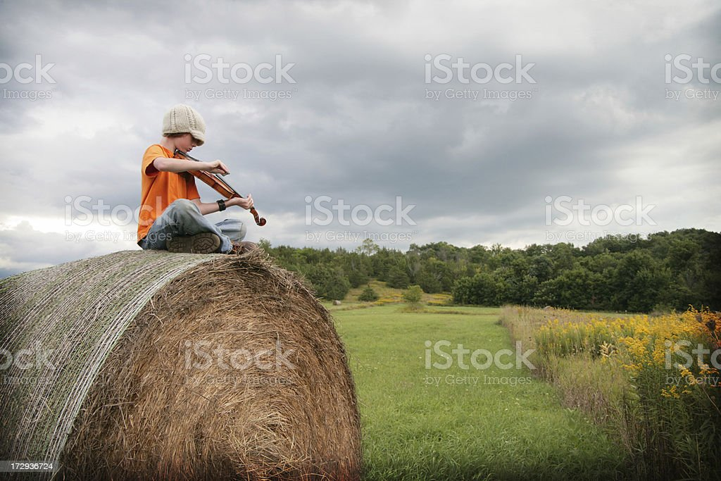 Haybale Fiddler Series royalty-free stock photo