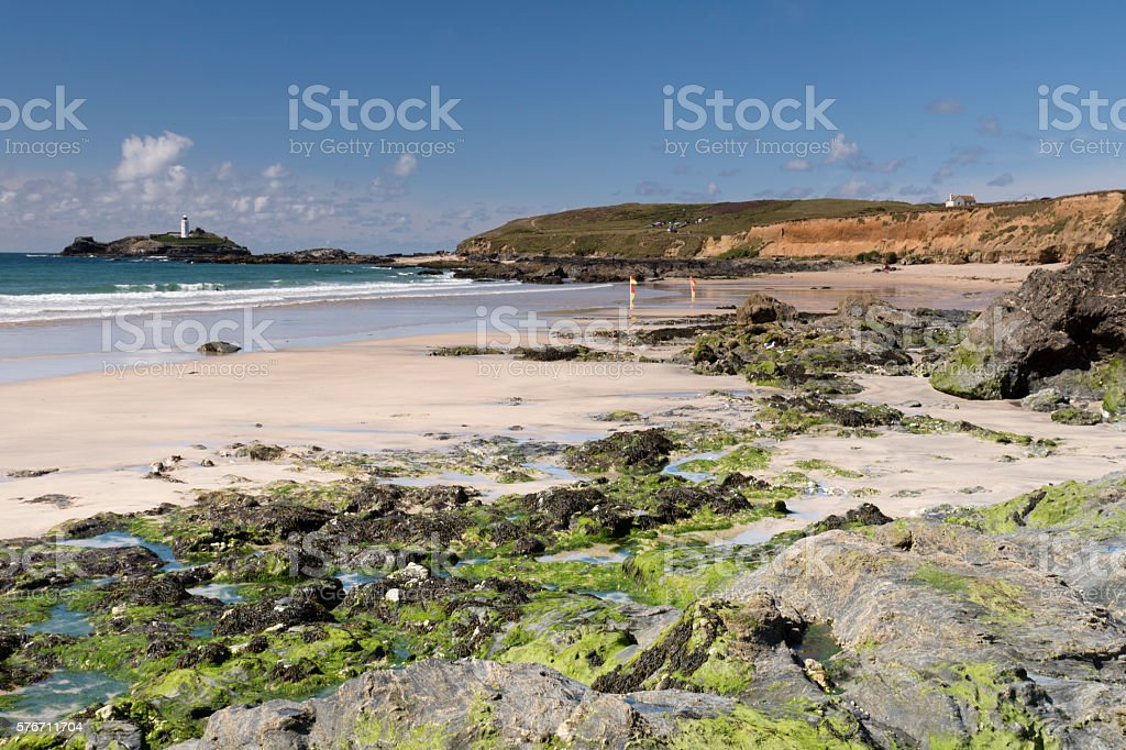 Hayle beach, Cornwall in summer facing Godrevy Lighthouse stock photo