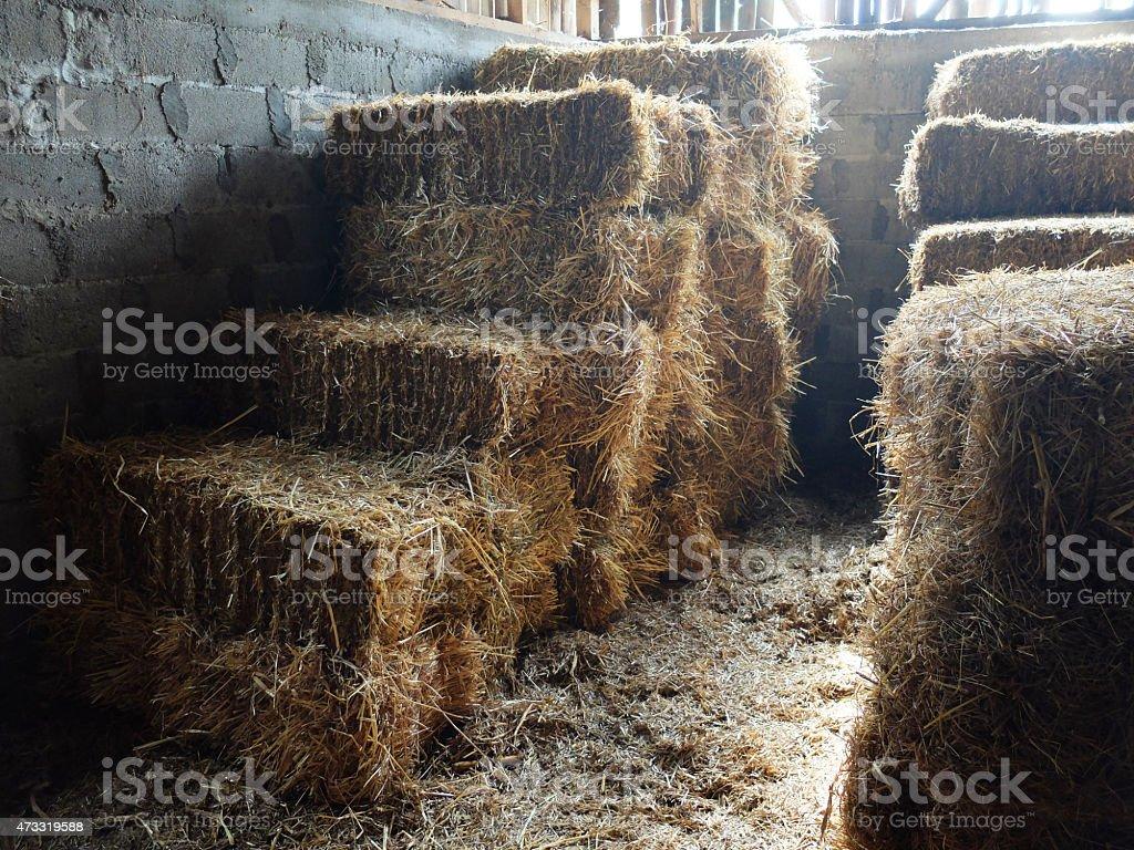 Hayloft - Bales of Straw on the farm stock photo