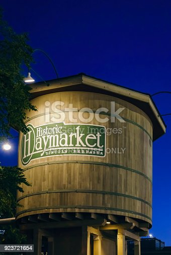 Nebraska, USA - Aug 8, 2017: Historic Haymarket Water Tower by night, at the Haymarket district of Lincoln city.