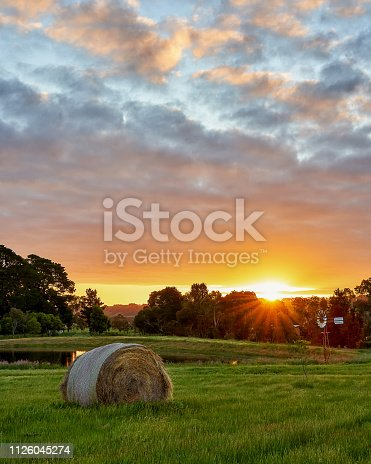 A haystack is lit up by a beautiful setting sun near Melbourne, Australia