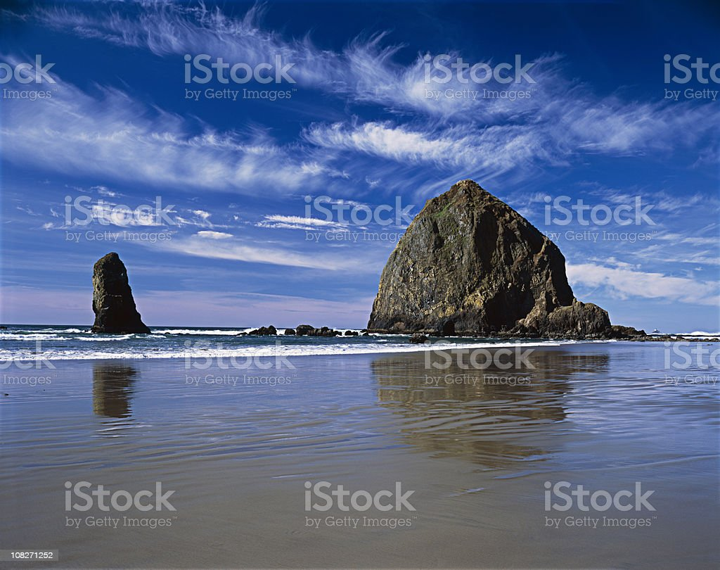 Haystack Rock blue sky white clouds Oregon Coast, Pacific Northwest stock photo