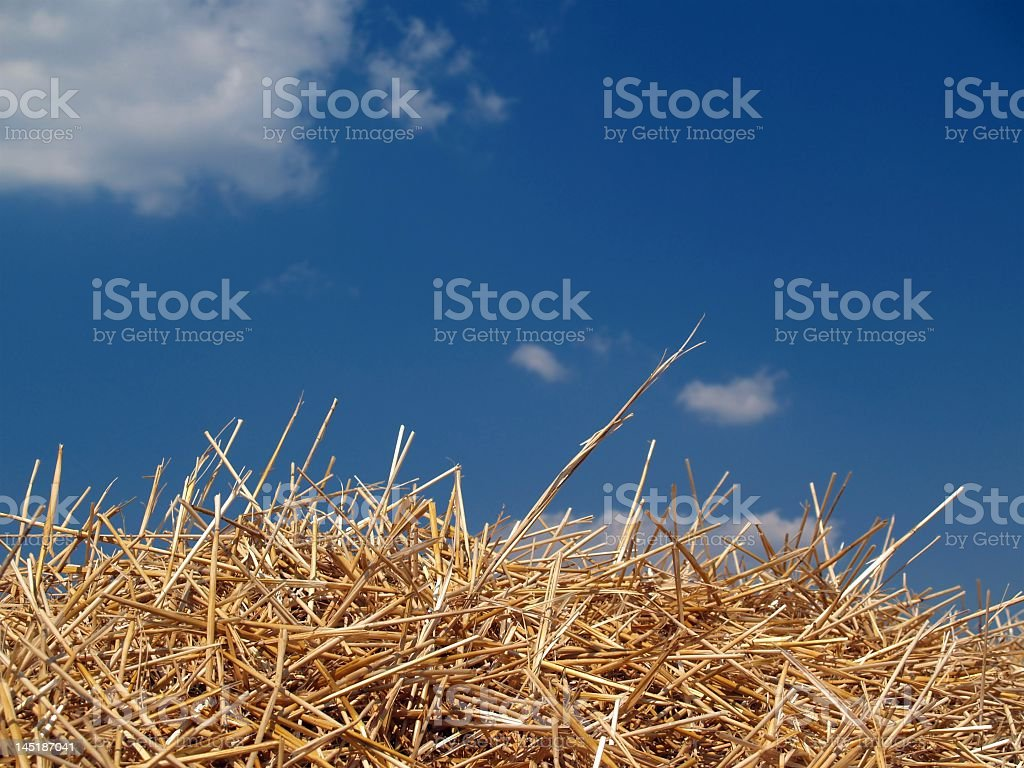 Haystack with blue sky and small amount of clouds royalty-free stock photo