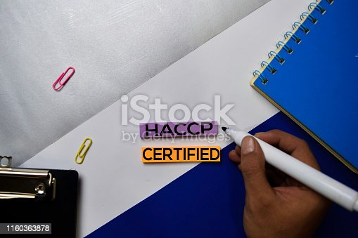 Hazard Analysis and Critical Control Point Certified (HACCP) text on sticky notes with color office desk concept