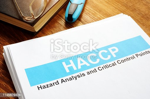 HACCP Hazard Analysis and Critical Control Points report on table.