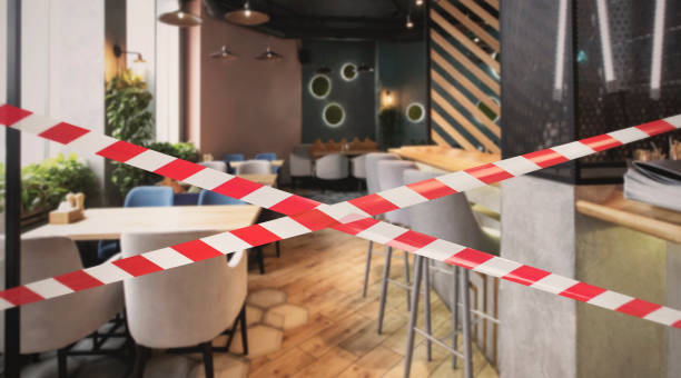 Hazard safety stripes across empty closed restaurant stock photo