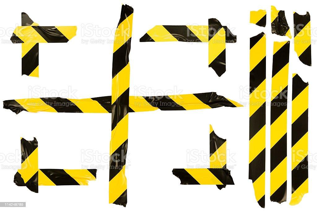 Hazard tape isolated on white background stock photo