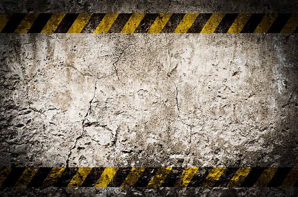 Hazard tape on blank dirty wall stock photo