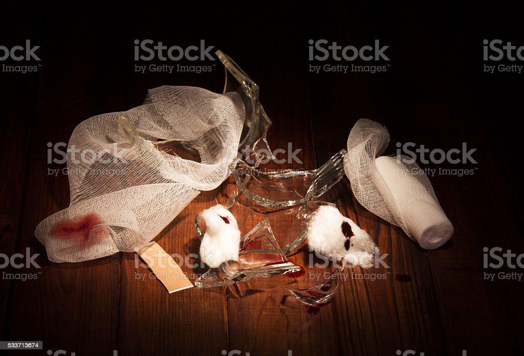 Hazardous debris glass, traces  wounds and bandage isolated on  black stock photo