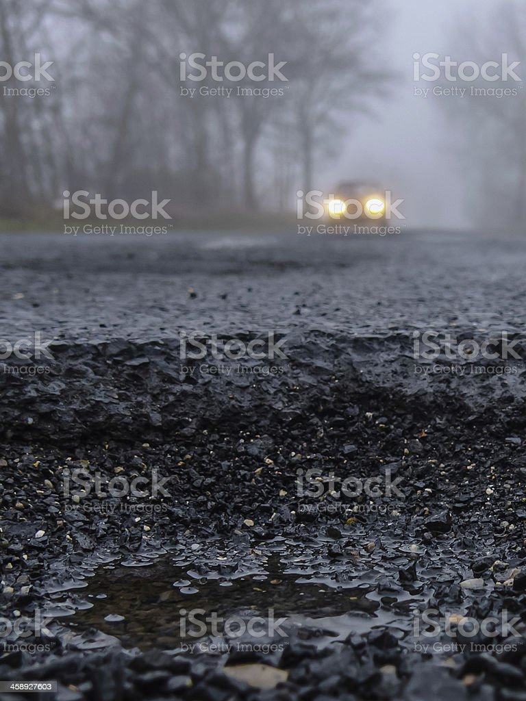 Hazardous foggy road stock photo