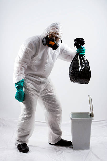hazardous trash - white suit stock photos and pictures