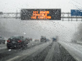 hazardous weather condition on the road seen through windshield