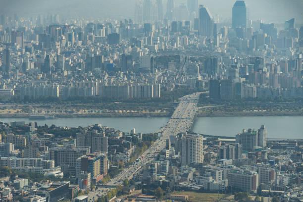 Haze over city of Seoul, South Korea with Han River stock photo