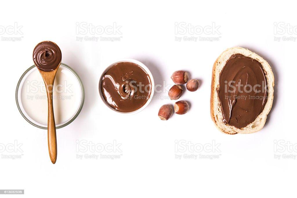 hazelnut spread over white background stock photo