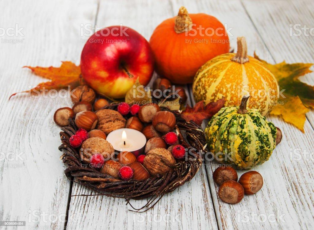 Hazelnuts and pumpkins stock photo