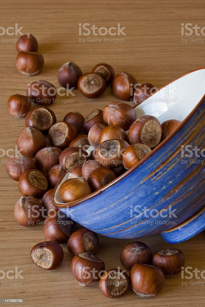 Hazelnuts Composition with a blue bowl stock photo